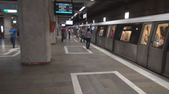 Subway train stops, opening doors, commuters going in or out, new transportation Stock Footage