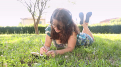Beautiful Young Woman at Park Writing on Notepad Stock Footage