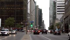 4K UHD - Busy downtown street at dawn with cars and modern skyscrapers Stock Footage