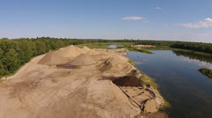 Aerial Fly Over Of A Sand Quarry And Lake Stock Footage