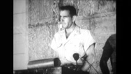Military officer talking on microphone while standing at podium Stock Footage