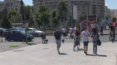 Pedestrians and bikers at zebra crossing, crowded street, green traffic light on Stock Footage