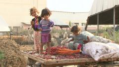 Beduin children of the Gaza Strip eating dates Stock Footage