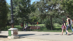 Quiet, peaceful promenade in the park, people walking relaxing, enjoy spare time Stock Footage