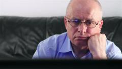 Senior man watching TV - stock footage