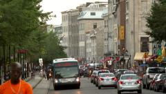 4K UHD - Public bus driving through crowd with old buildings in background Stock Footage