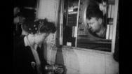 Workers using rivet gun at Willow run airplane plant Stock Footage