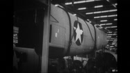 MCU derrick carrying rear section of fuselage of B-24 Liberator Stock Footage