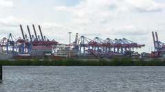 Gantry lift trucks, huge ship passing by Stock Footage