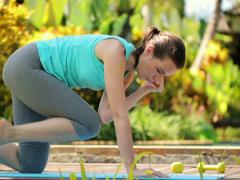 Young attractive woman exercising in the garden NTSC - stock footage