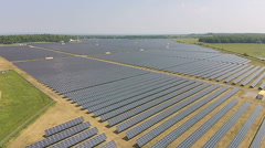 Flying Over A Large Solar Panel Farm Generating Station Stock Footage