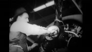 Worker tightens nut of propeller to aeroplane engine Stock Footage