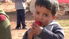 Child eating candy in a Syrian refugee camp Stock Footage
