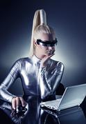 Beautiful cyber woman working on her laptop .... Stock Photos