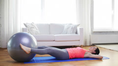 Girl exercising with fitness ball at home Stock Footage
