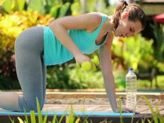 Young woman exercising with dumbbells in the garden NTSC - stock footage