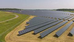 Flying Over A Commercial Green Energy Solar Panel Farm Stock Footage