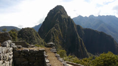 Huayna Picchu towering above the ruins of Machu Picchu Stock Footage