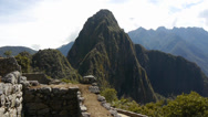 Stock Video Footage of Huayna Picchu towering above the ruins of Machu Picchu