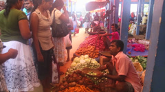 Local men selling and women buying at Hikkaduwa Sunday market. Stock Footage