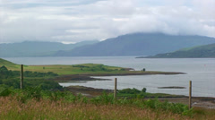 The Highlands of the Great Britain Island from Mull, behind loch Stock Footage
