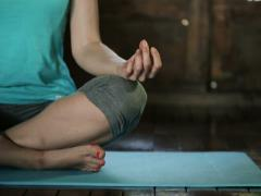 Young woman meditating on floor at home NTSC Stock Footage