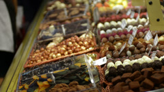 Home made sweets in Barcelona market rack focus HD Stock Footage