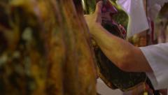 Barcelona Market vendor slicing smoked ham HD Stock Footage