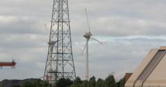 4k, wind turbine, windmill and power pole Stock Footage