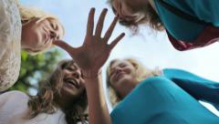 cute women in the park: friendship, team, encouragement, joy, hands, promises - stock footage