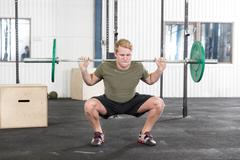 Squats training at fitness gym center Kuvituskuvat