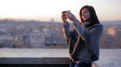 Beautiful woman posing to take a selfie with her smartphone at sunse Stock Footage