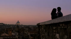 Silhouette of young couple in love, hugging and kissing, Rome background Stock Footage