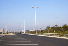 Empty tarmac road and parking places at durban beachfront Stock Photos