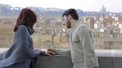 Young couple in love in Rome: engagement, caresses, hugs, romantic partners Stock Footage