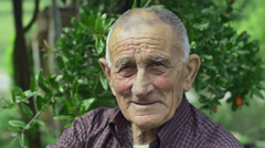 smiling old man from countryside: closeup portrait of a wrinkled and serene face - stock footage