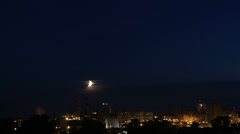 Sunset moon over the city Stock Footage