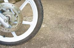 Old black magnesium alloy wheel of motorcycle and disc brake Stock Photos