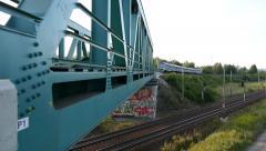 Passenger Train passes through the Bridge Stock Footage