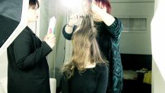 Stock Video Footage of Hairstylist preparing hairdo on fashion model