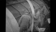 Military soldiers building quonset hut Stock Footage