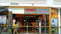 GNC storefront shopping mall - stock footage