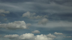 Light and fluffy clouds in a summer sky 4K Stock Footage