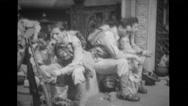 Military men eating packed lunches Stock Footage
