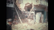 Military soldier passing by debris of damaged building Stock Footage