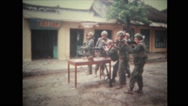 Soldiers firing with M60 machine gun from behind the table Stock Footage