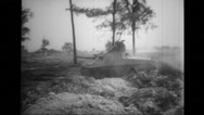 Military tank rolling in fields Stock Footage