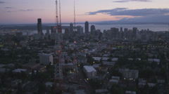 Aerial sunset view Seattle, Queen Anne Hill and 3 television masts, USA Stock Footage