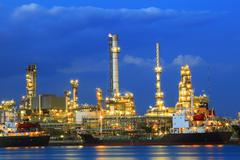 heavy industry land scape of petrochemical refinery plant  with beautiful lig - stock photo