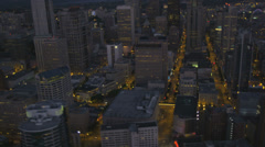 Aerial dusk view Seattle skyscrapers illuminated  Ferris wheel, USA Stock Footage